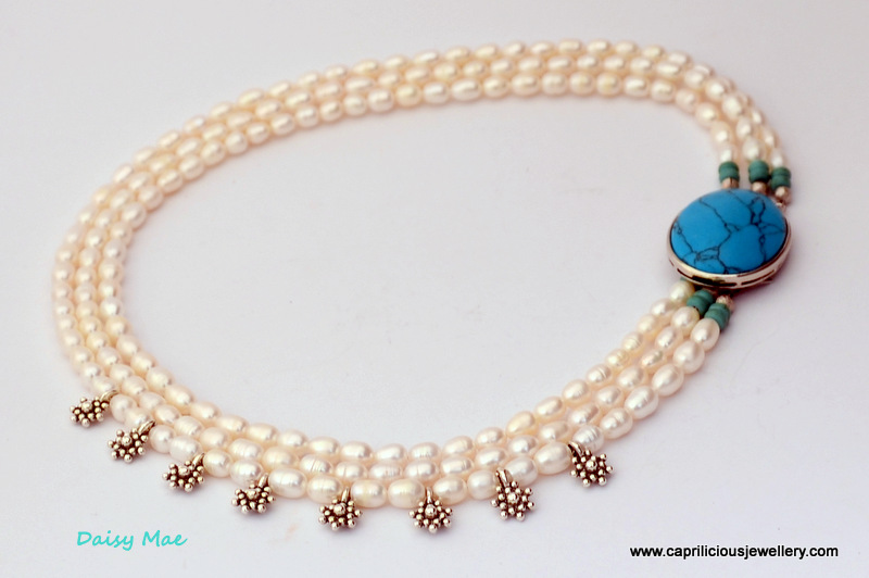 Multi strand pearl necklace with a whimsical touch and turquoise clasp by Caprilicious
