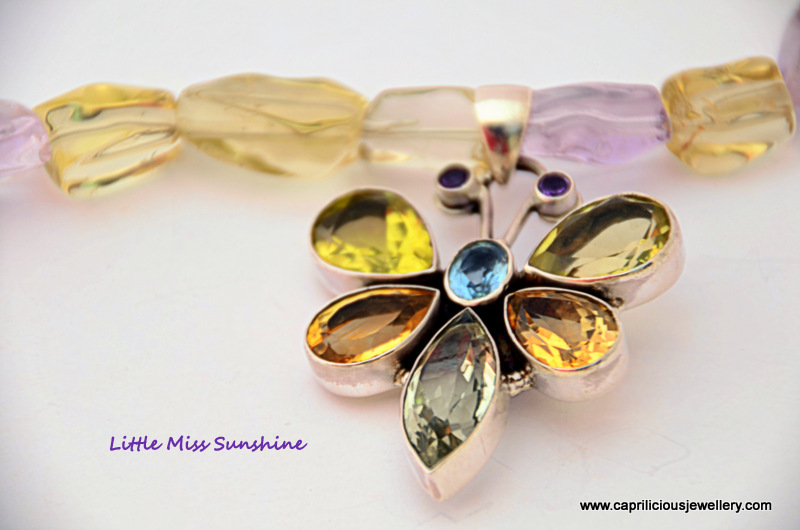 Sterling silver and semi precious gemstone butterfly pendant on an ametrine necklace with earrings to match by Caprilicious Jewellery