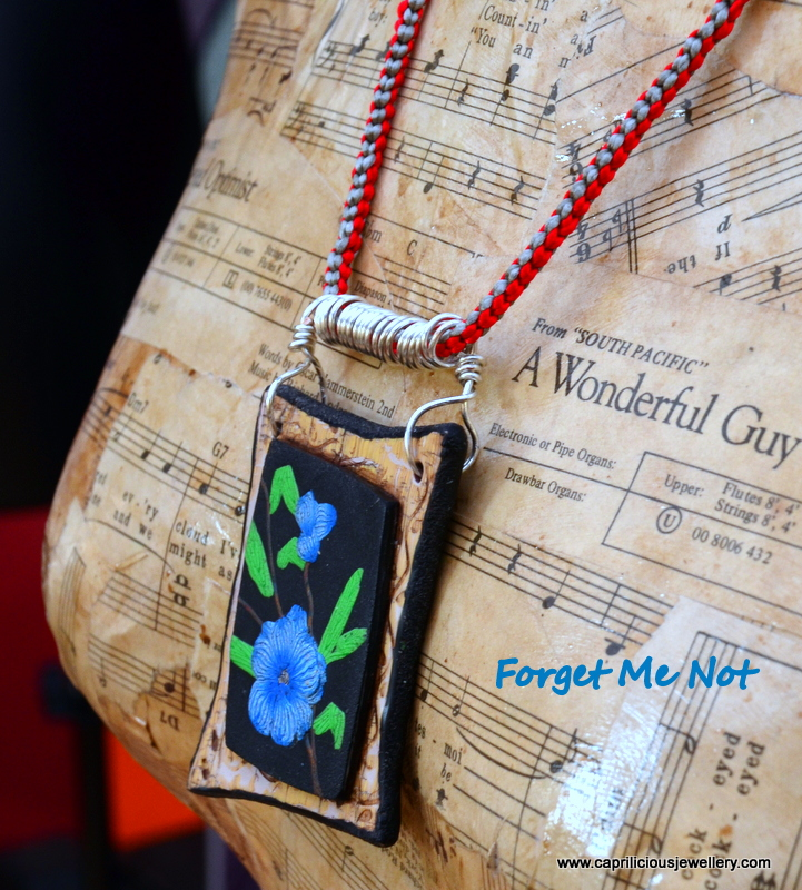 Forget Me Not - polymer clay pendant on a Kumihimo Braid by Caprilicious Jewellery