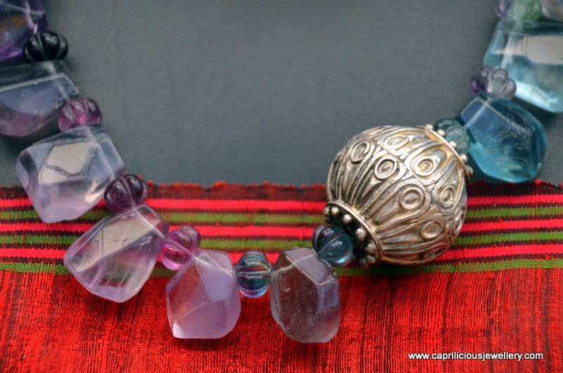 Fluorite teardrop beads and Moroccan focal bead in a colourful necklace by Caprilicious Jewellery
