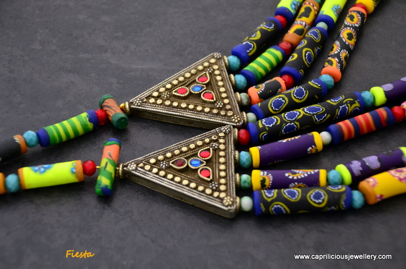 Fiesta - a polymer clay bead multistrand necklace with tribal connectors by Caprilicious Jewellery