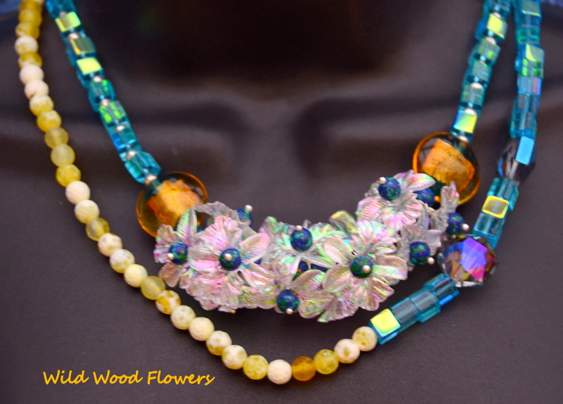 Evening necklace with shiny lucite flowers, crystals and Czech glass to go with your LBD by Caprilicious Jewellery