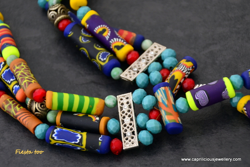Fiesta too- a polymer clay bead multistrand necklace with tribal connectors by Caprilicious Jewellery