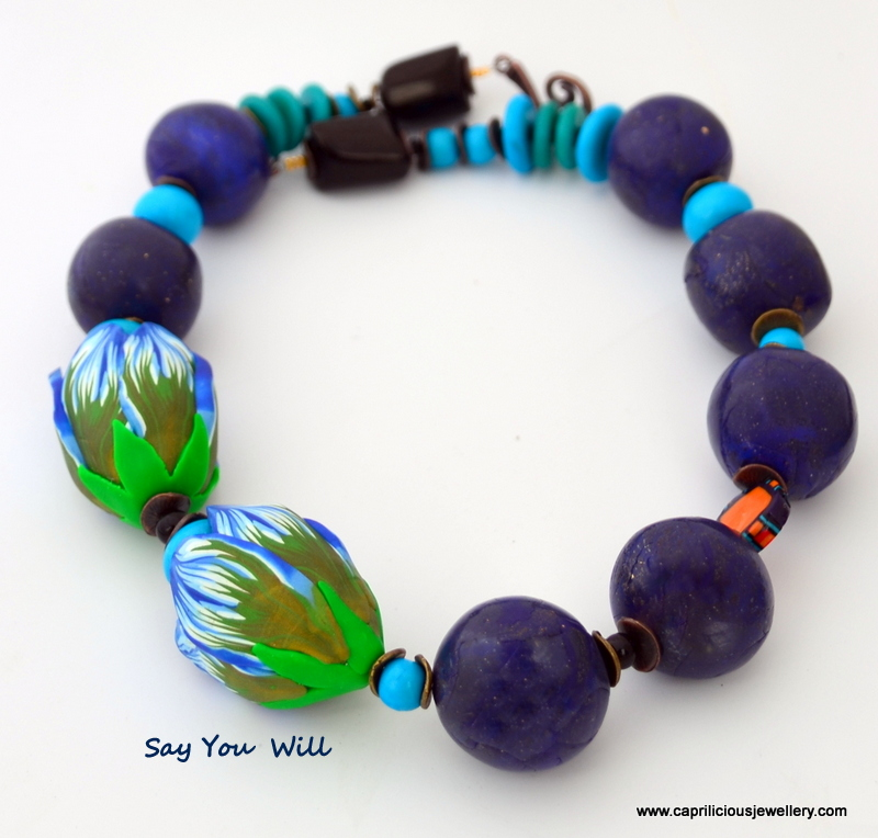 Polymer clay faux lapis lazuli beads and tulip beads in a necklace by Caprilicious Jewellery