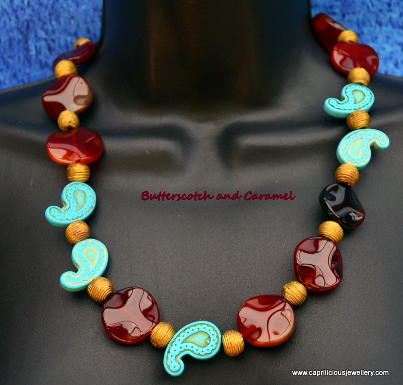 Carnelian and African Baule beads with magnesite in a necklace by Caprilicious Jewellery