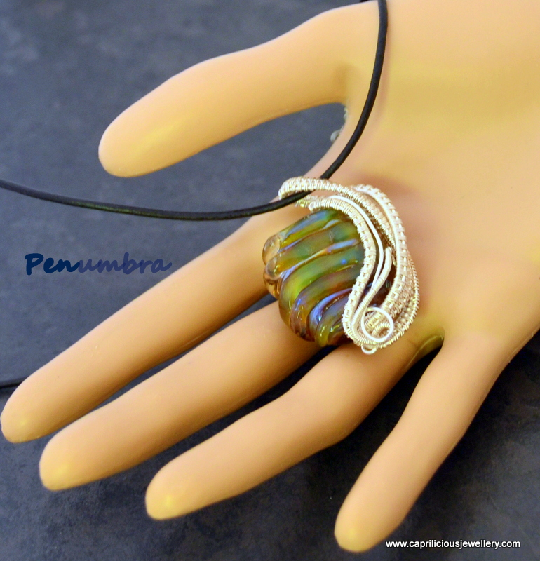 Lampwork glass bead in wire work by Caprilicious Jewellery