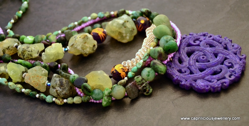 multistrand necklace, prehnite rough cut nuggets, ruby with zoisite and turquoise and a hand carved dyed jade pendant by Caprilicious Jewellery