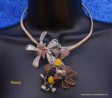 Wire woven torque necklace with hand woven flowers by Caprilicious Jewellery