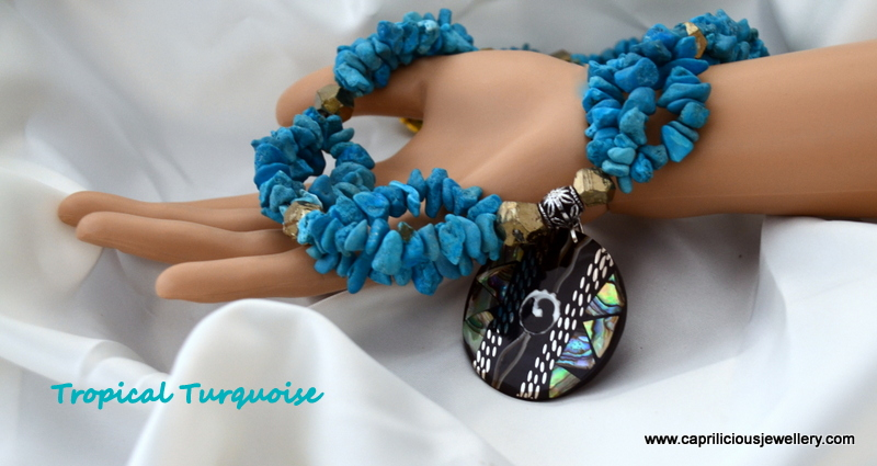 Turquoise and Pyrite with a shell pendant from Caprilicious Jewellery