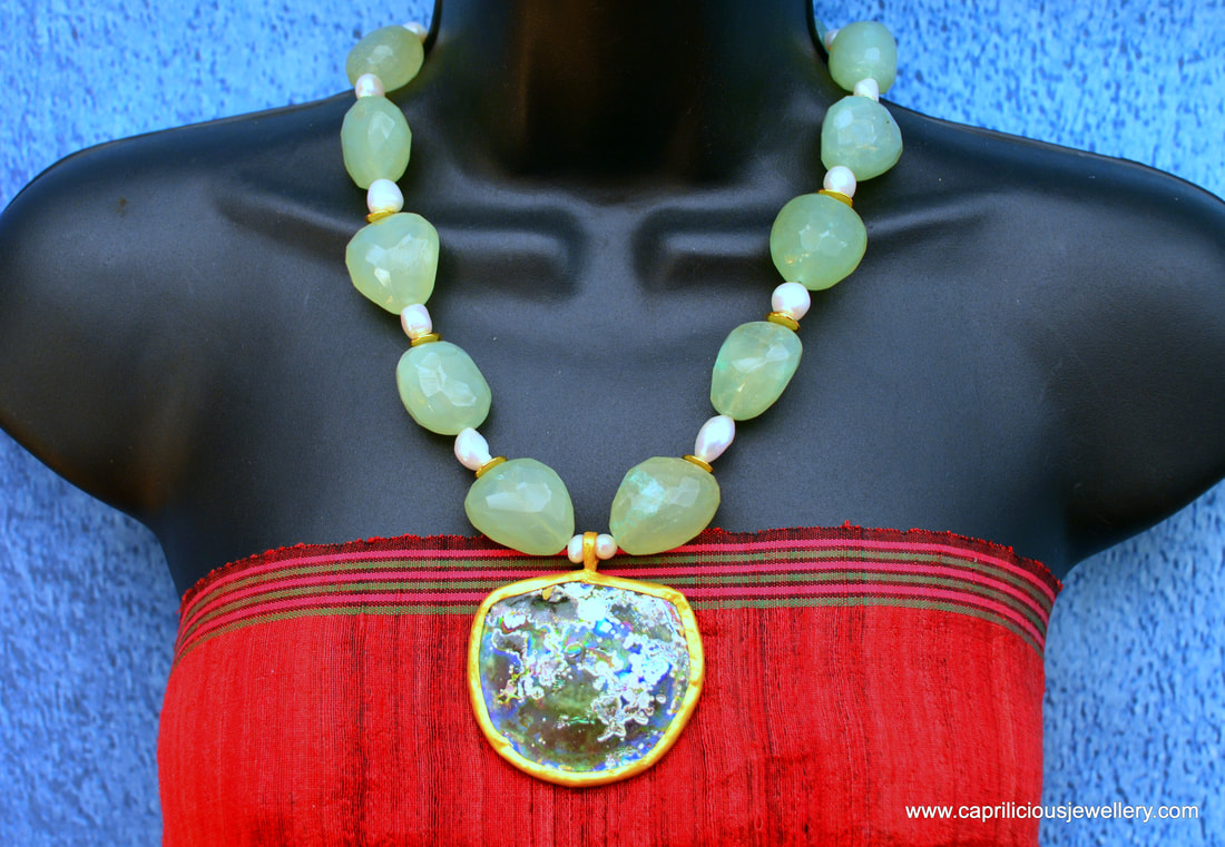 Aurelia, a sea glass pendant with chalcedony sea green nugget beads by Caprilicious Jewellery