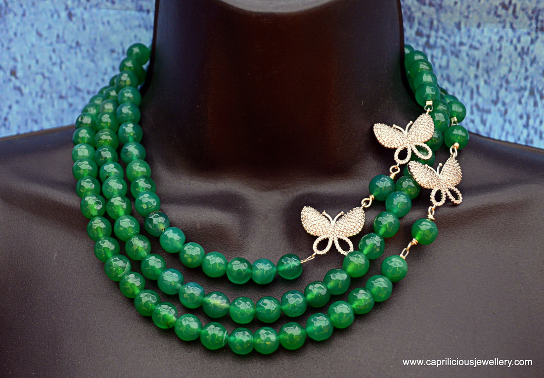 A multi strand onyx and diamante butterfly necklace by Caprilicious Jewellery