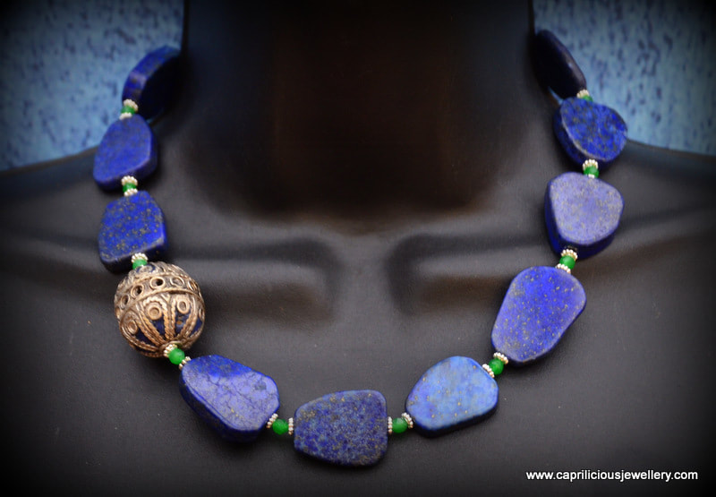 Lapis slab nugget necklace with a Moroccan enamelled bead by Caprilicious Jewellery