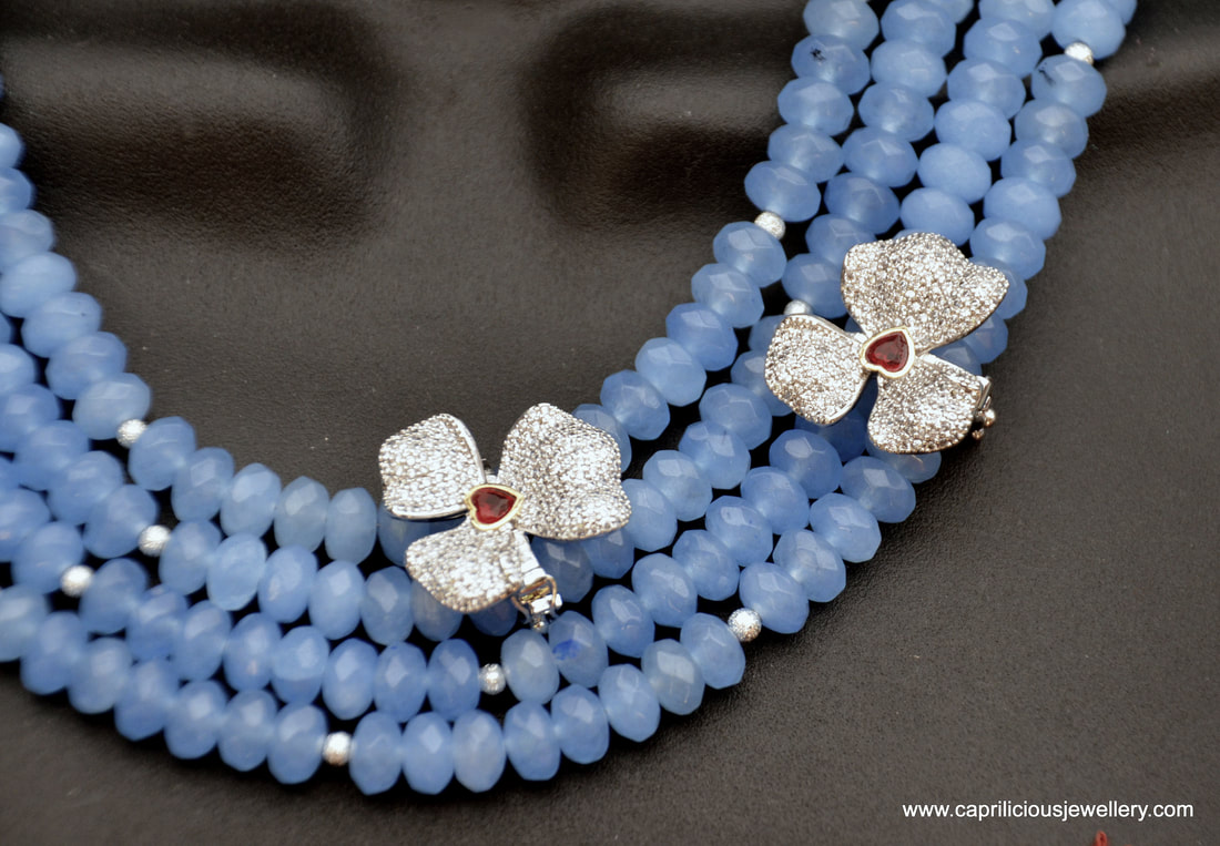 Four strands of blue chalcedony, diamante orchids, statement necklace by Caprilicious Jewellery