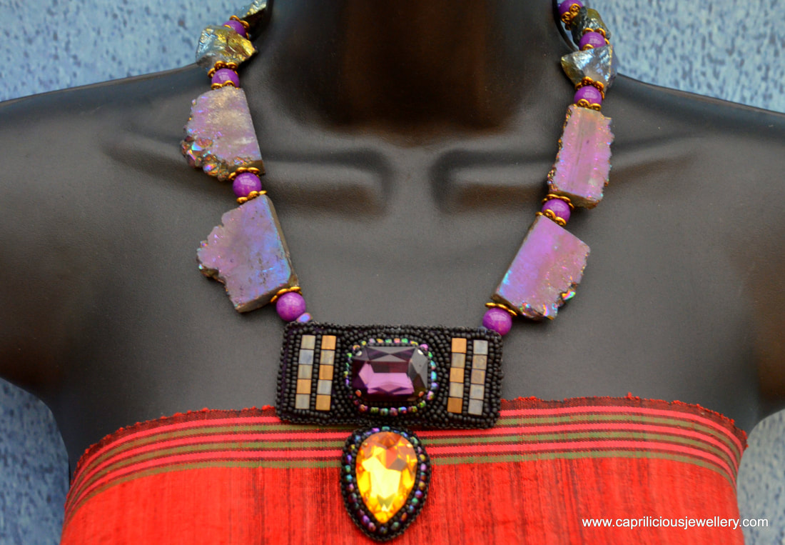 Jezebel, a statement necklace in purple crystals and titanium coated druzy by Caprilicious Jewellery