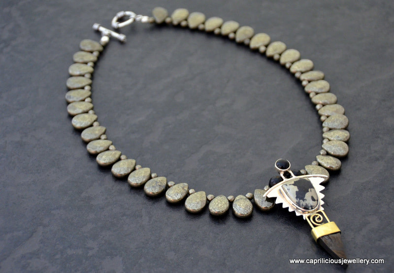 Magnetite/pyrite and sterling silver pendant in a pyrite necklace by Caprilicious Jewellery