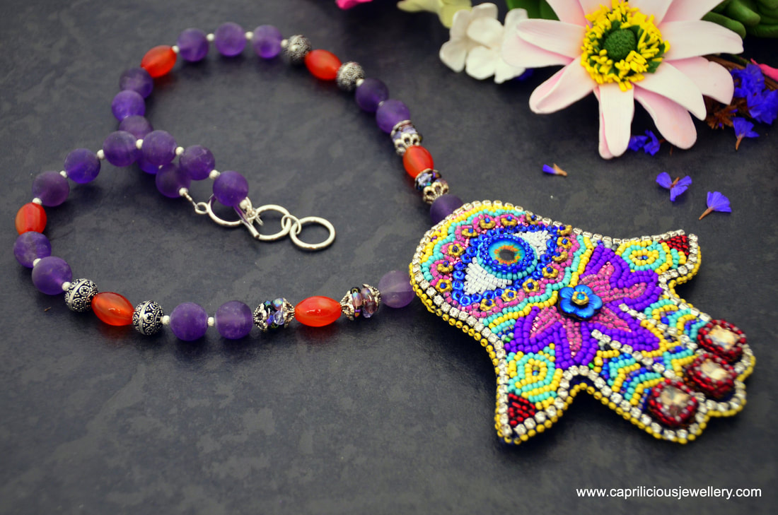 Yogini, yoga jewellery, lotus jewellery, meditation jewellery, Hamsa, amulet, protection jewellery, colourful jewellery, hand embroidered, beaded necklace, amethyst, carnelian
