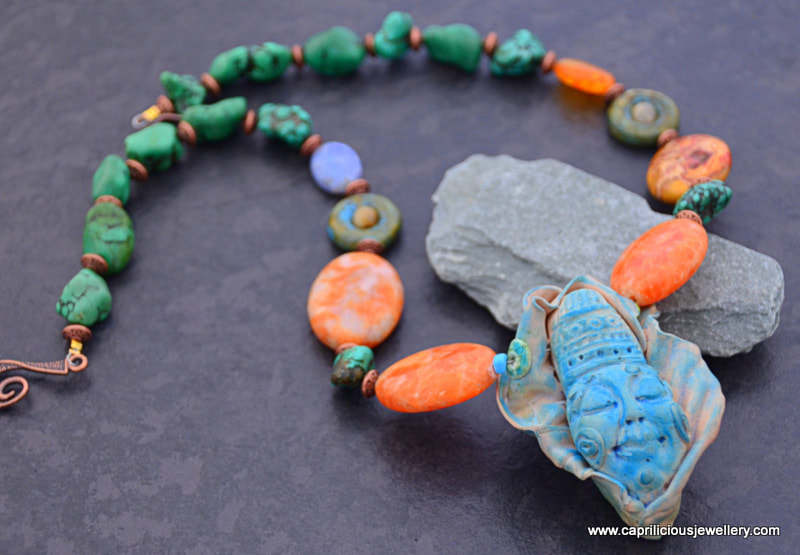 Yemoja - a tribal necklace with orange agate and turquoise by Caprilicious Jewellery
