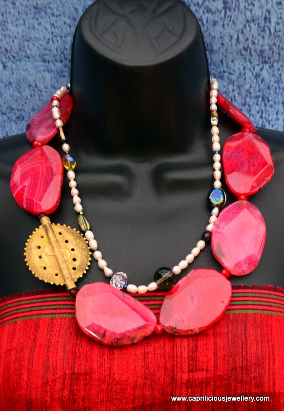 Red agate slab nuggets and Baule Sun bead tribalistic necklace by Caprilicious Jewellery