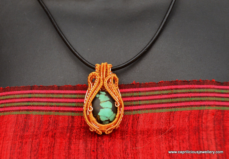 Wirework and turquoise pendant by Caprilicious Jewellery
