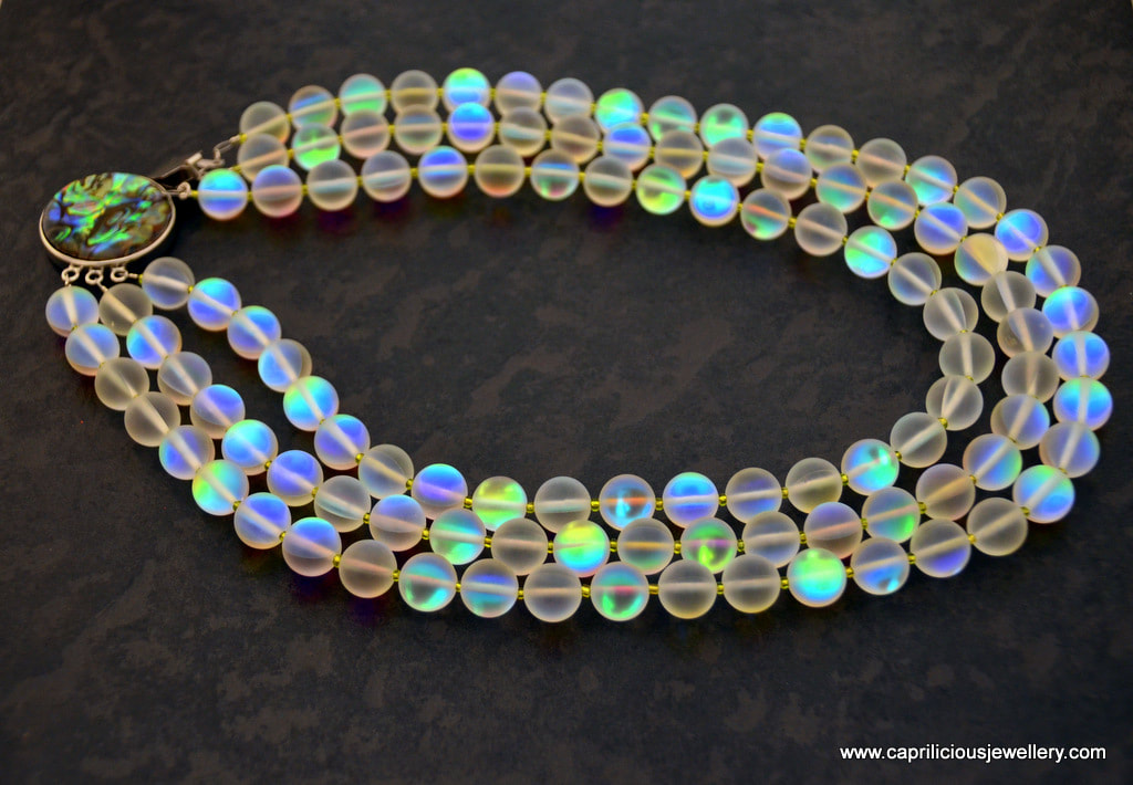 Aura - frosted glass opalite beads with an AB coating, and shell clasp by Caprilicious Jewellery