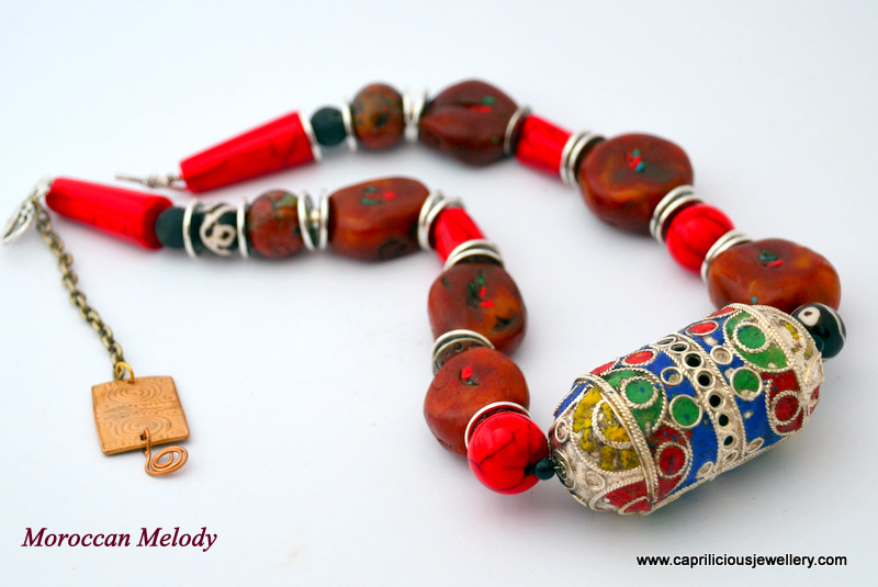 Moroccan Melody a Statement necklace, Moroccan enamelled amulet bead, polymer clay beads, faux amber beads by Caprilicious Jewellery