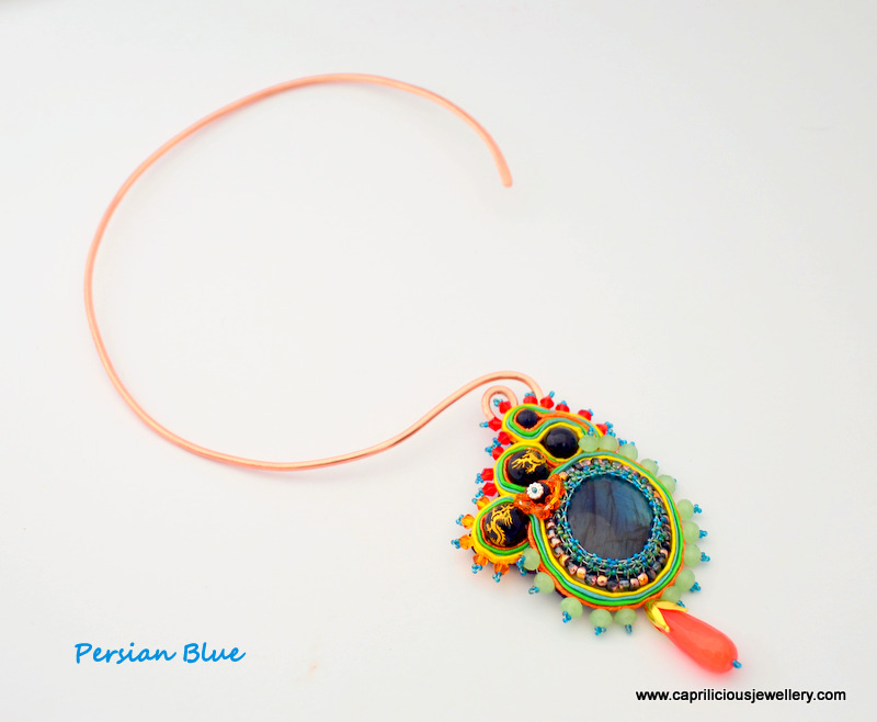 Blue Labradorite pendant with beadwoar and soutache on a copper torque necklace by Caprilicious Jewellery