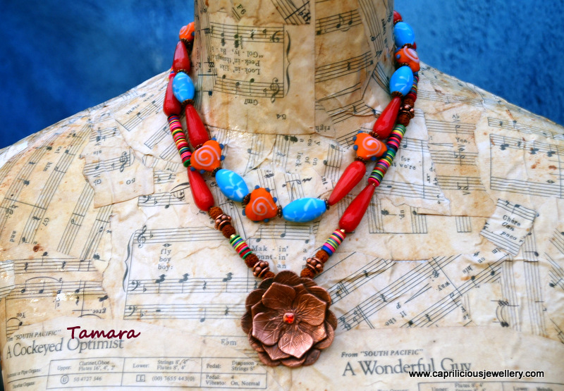 Tamara - Copper clay lotus pendant, ceramic beads, African vinyl beads, Milagro heart beads necklace, hand made polymer clay inlaid clasp by Caprilicious Jewellery