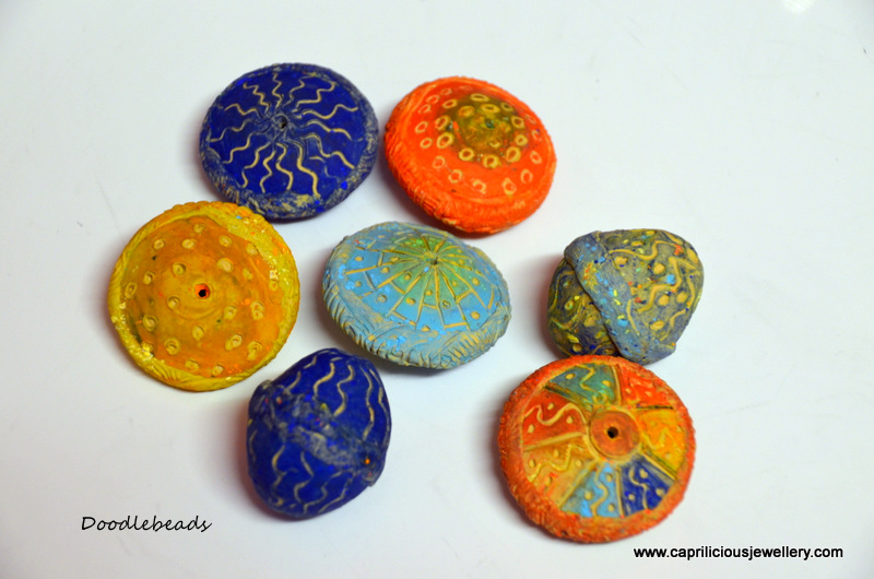 Hollow polymer clay beads by Caprilicious