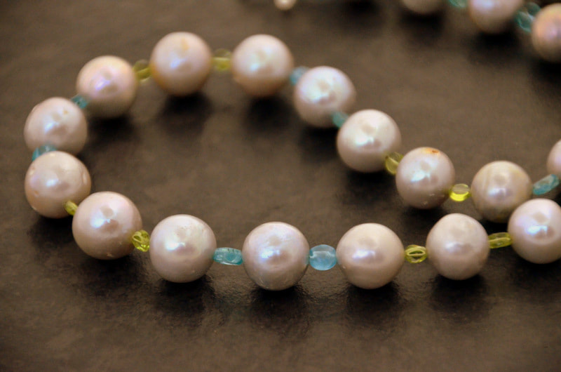 Silvery baroque pearls, with apatite and peridot in a beautiful statement necklace by Caprilicious Jewellery