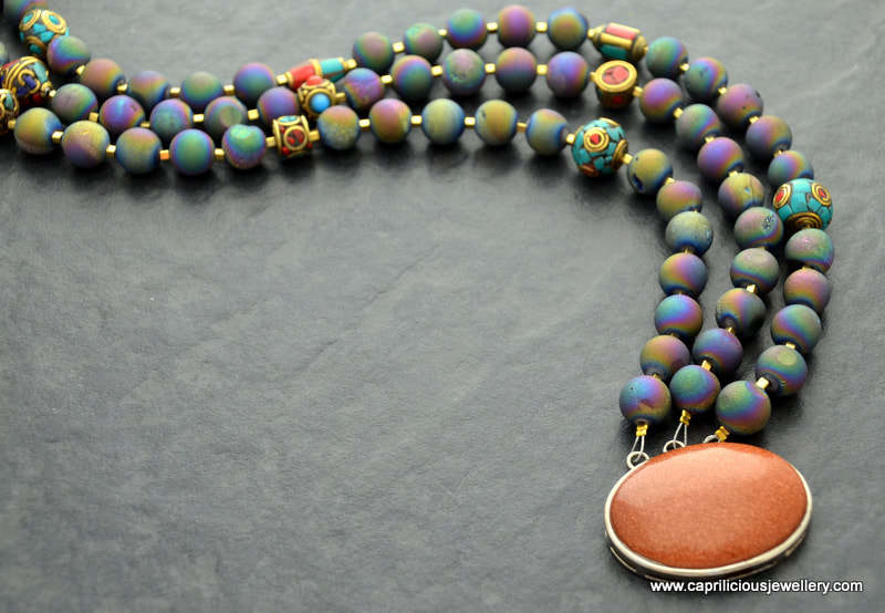 The oil slick necklace, titanium coated druzy and Tibetan beads by Caprilicious Jewellery