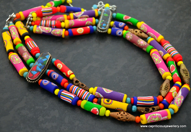 Polymer clay trade bead necklace in three strands by Caprilicious Jewellery