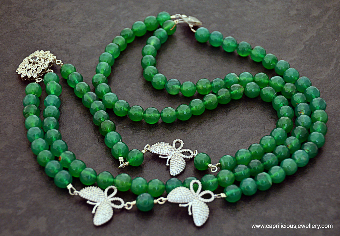 Green onyx and diamante butterfly three strand necklace by Caprilicious Jewellery