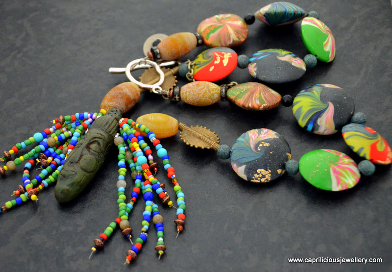 Tribal polymer clay necklace, with lentil swirl 'cosmic' beads by Caprilicious Jewellery