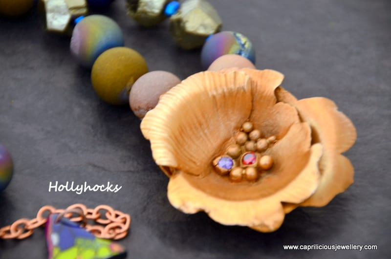 Hollyhocks - bronze clay flower, druzy agate beads, handmade wire clasp, polymer clay and resin butterfly wing made by Caprilicious Jewellery