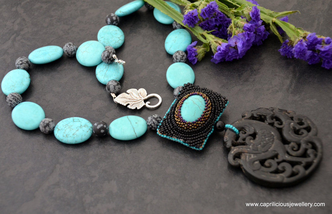 A beadwork turquoise and jade pendant with a turquoise and chrysanthemum stone necklace by Caprilicious Jewellery