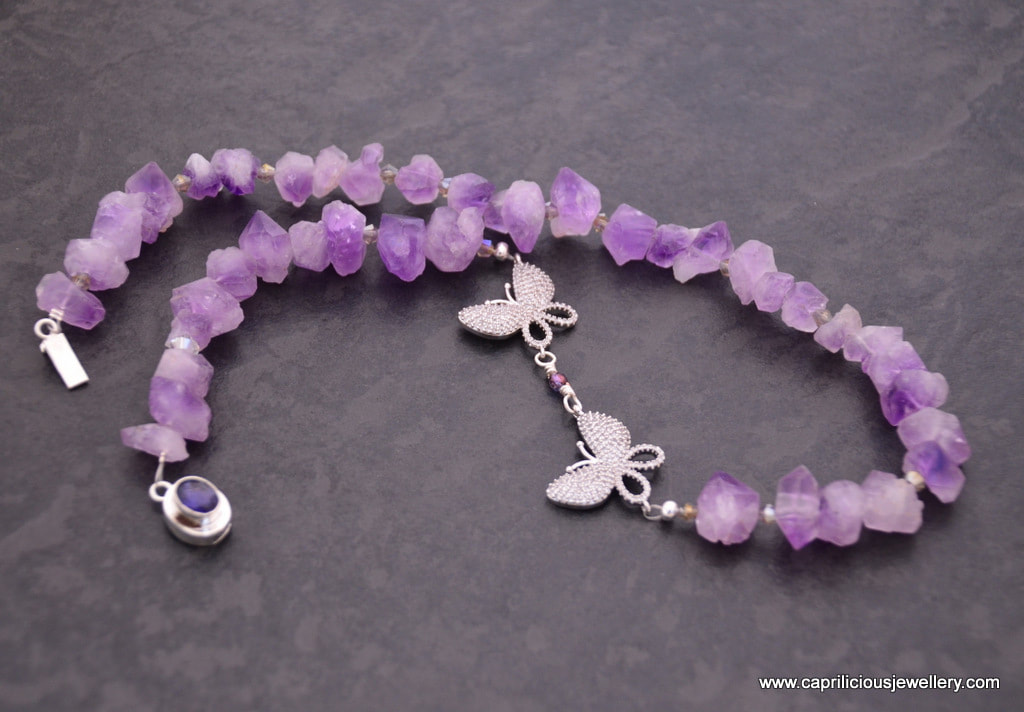 Frou Frou, an amethyst nugget necklace with micro pave diamante butterflies by Caprilicious Jewellery