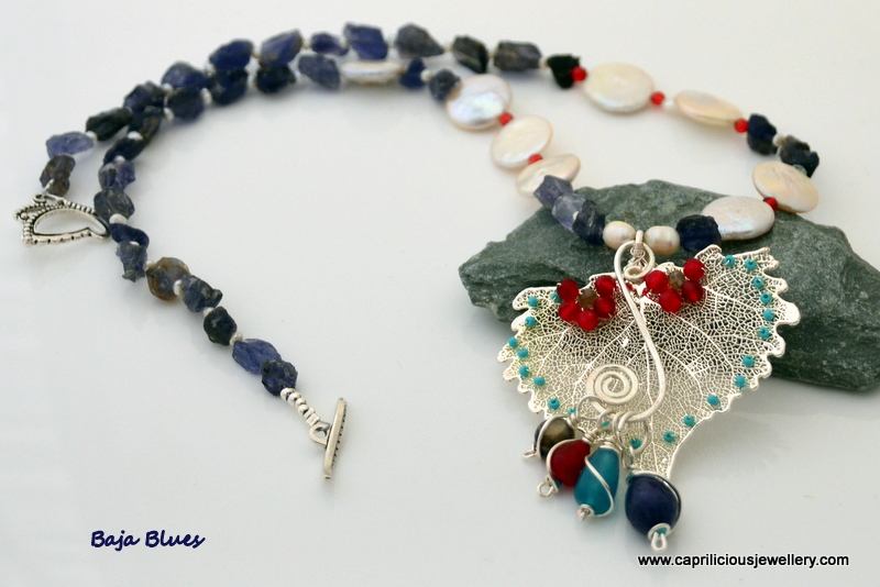 Baja Blues - Cottonwood leaf skeleton and kyanite rough nugget and coin pearl necklace by Caprilicious Jewellery