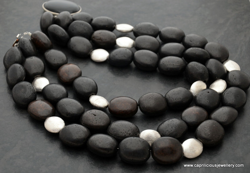 Black ceramic beads in a multistrand necklace by Caprilicious Jewellery
