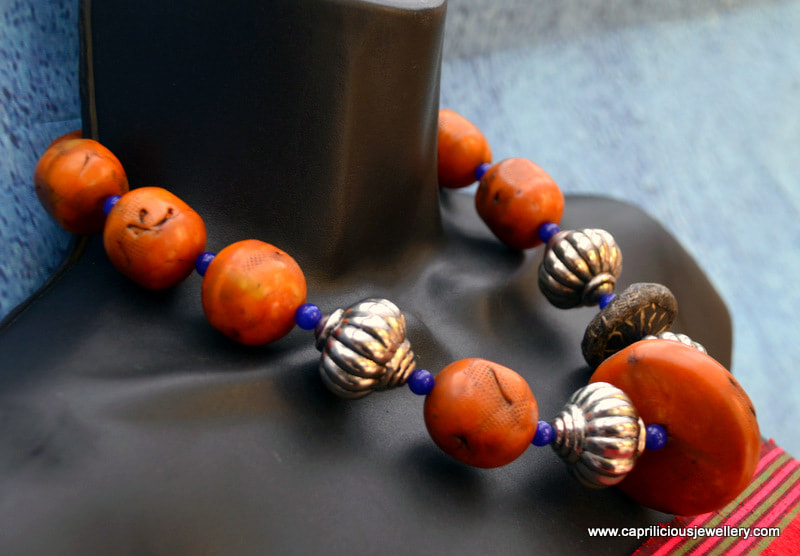 Tribal faux amber necklace with polymer clay beads  by Caprilicious Jewellery