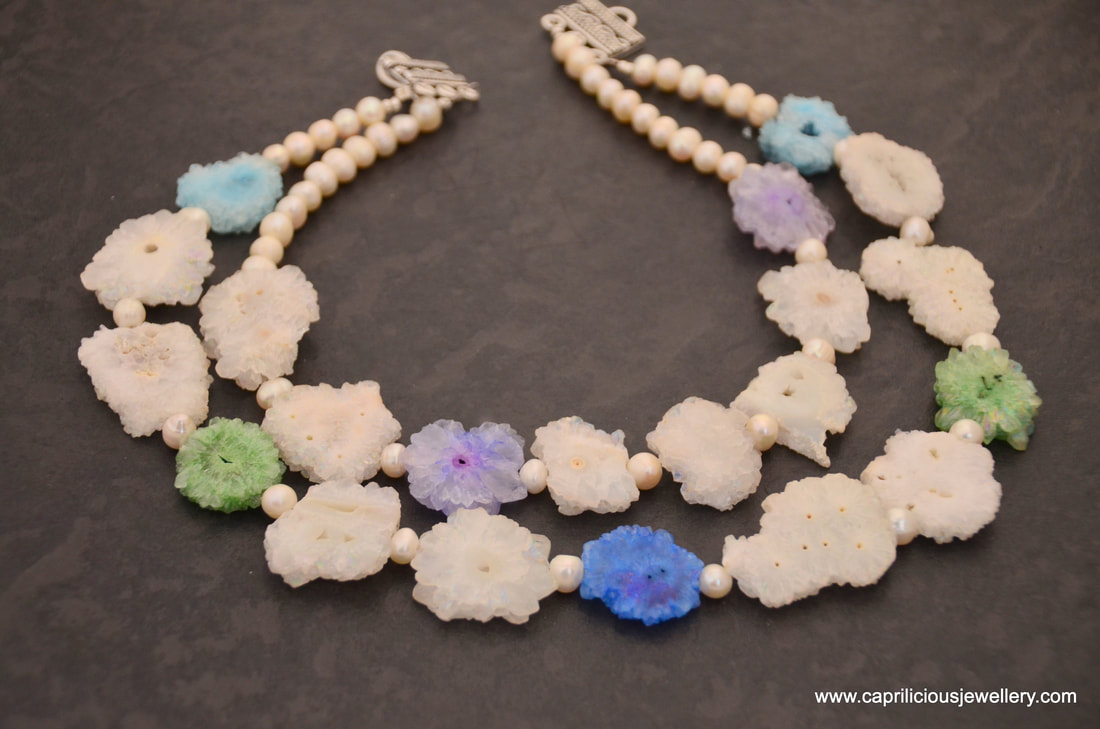 Cara - a two strand necklace of solar quartz slices of stalactites with freshwater pearls by Caprilicious Jewellery