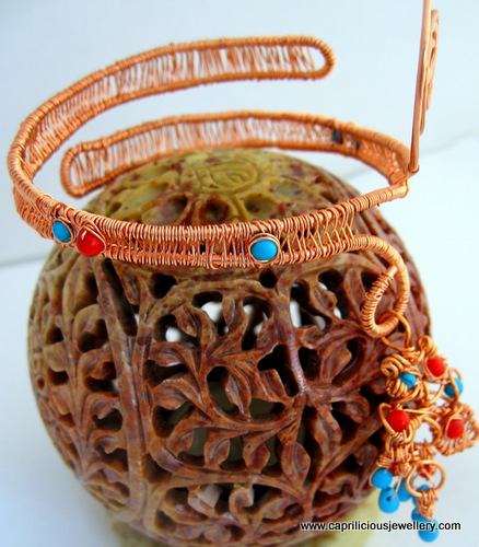 Copper wire armband embellished with coral and turquoise beads by Caprilicious Jewellery