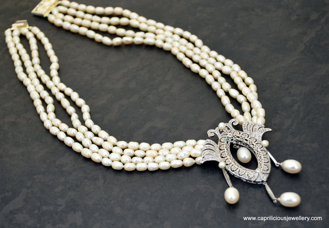 Pearl necklace with micro pave pendant