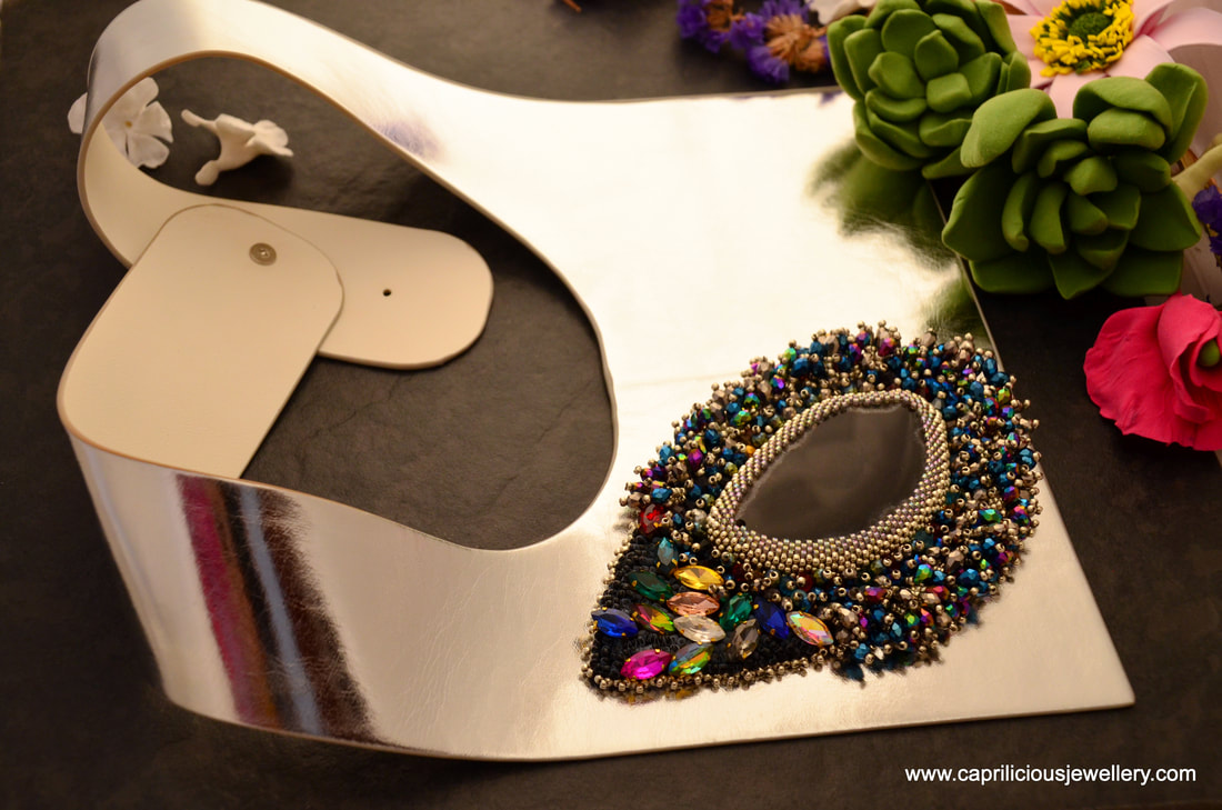 Comet, a hand beaded slab nugget on a leather necklace by Caprilicious Jewellery