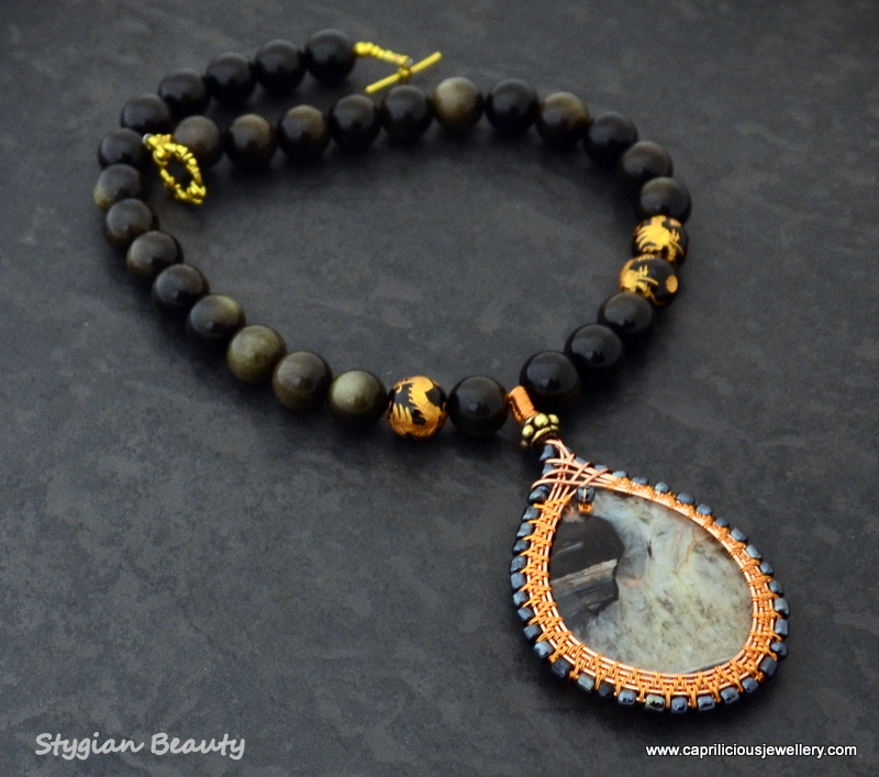 Stygian Beauty - golden obsidian with a wireworked agate pendant by Caprilicious Jewellery