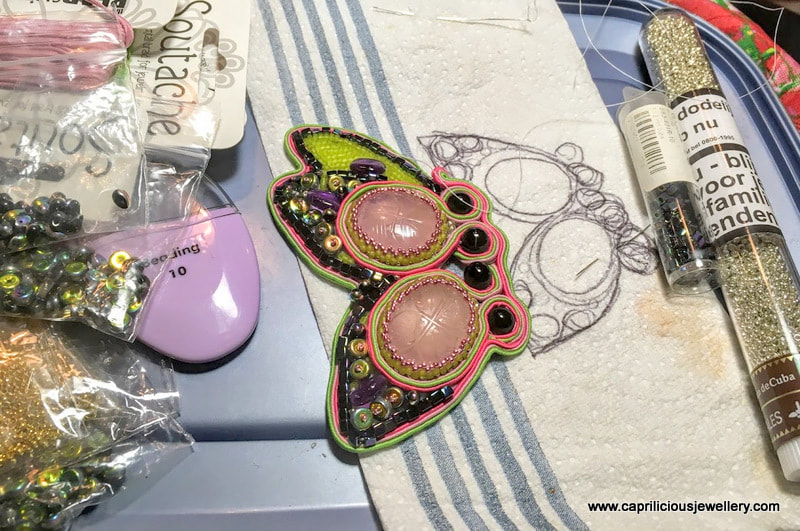 WIP photographs of a soutache butterfly pendant
