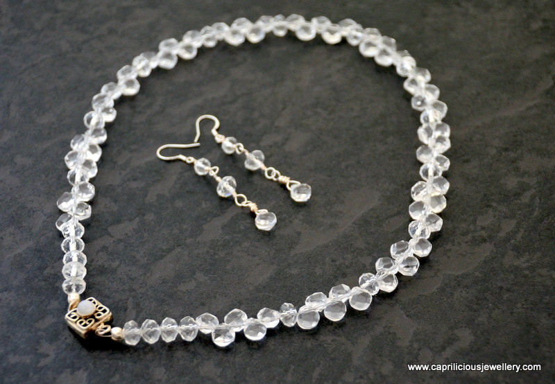 Necklace of clear quartz teardrop beads with a silver clasp, earrings to match by Caprilicious Jewellery