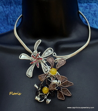 Floris - torque necklace with a floral theme in hand woven flowers by Caprilicious Jewellery