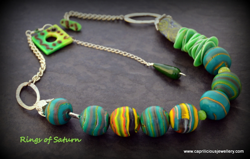 Polymer clay bead necklace - Rings of Saturn by Caprilicious Jewellery