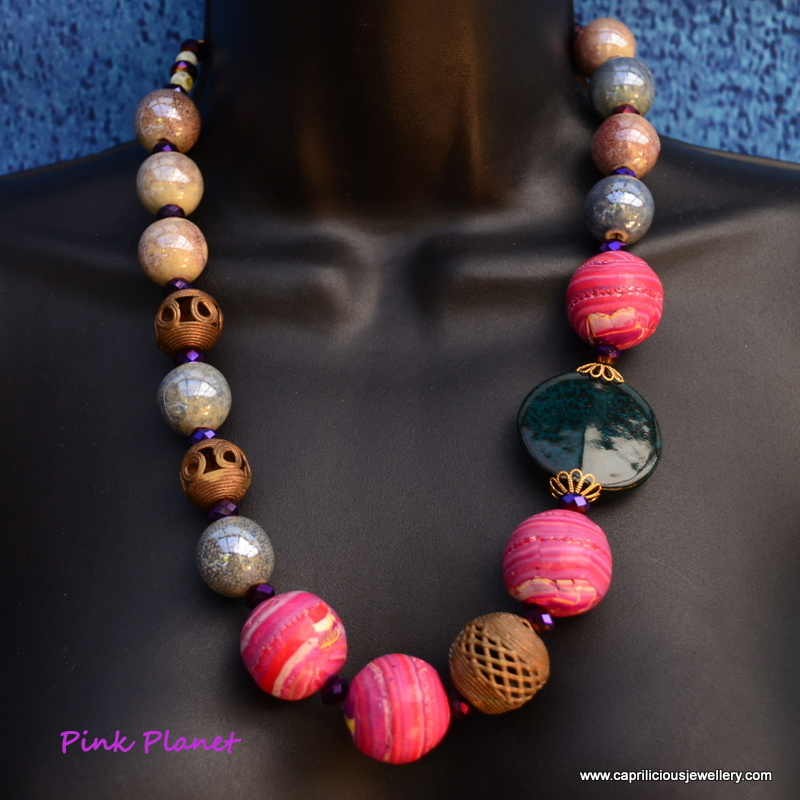 The Pink Planet - a multimedia necklace by Caprilicious Jewellery