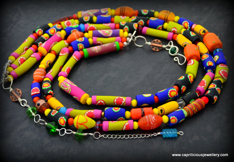Fiesta - polymer clay beads, faux trade beads in a tribal necklace by Caprilicious Jewellery